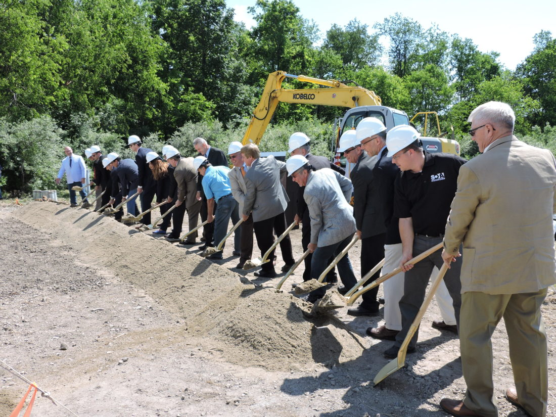 Local and state government officials, along with representatives of Pietro Fiorentini, area development officials and other guests take part in a ceremonial groundbreaking Friday for the company's new Weirton operations. The $5.5 million facility will be located in the Three Springs Business Park. The shovels used in the ceremony were produced by Bully Tools, of Wintersville. -- Craig Howell