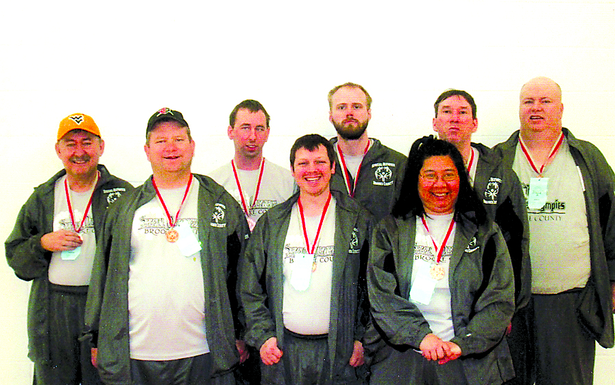 BRONZE WINNERS — The Brooke County Special Olympics basketball team placed third at the West Virginia Special Olympics Basketball Tournament, earning bronze medals. The team's members are, front, from left, Danny Adams, Jimmy Hunter and Marie Kosut; and back, Mark Pollock, Matt Elcesser, Brandon Klages, A.J. Smith and Ronnie Taylor. -- Contributed