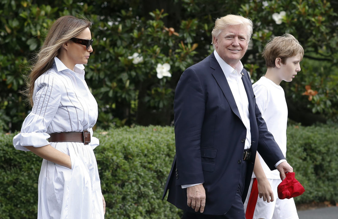 OFF TO CAMP — President Donald Trump, first lady Melania and their son, Barron, walk to Marine One across the South Lawn of the White House in Washington, Saturday, en route to Camp David in Maryland. -- Associated Press