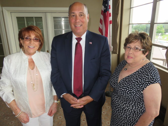 MEETING HIGHLIGHTS — Iris Craig, left, president of the OFWC-GFWC Woman's Club of Steubenville, welcomed Steubenville City Manager Jim Mavromatis and Pat Ketzell, president of the Southeast District GFWC/Ohio, to the club's June meeting. -- Janice Kiaski