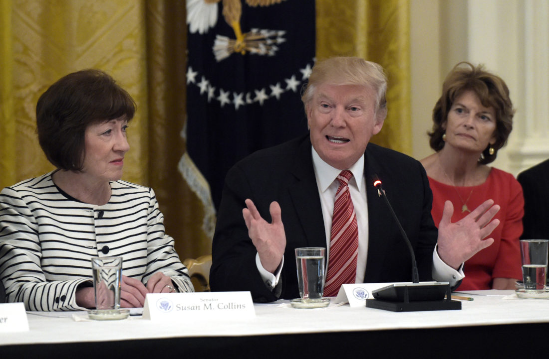 MAKINGADEAL? — President Donald Trump, center, speaks as he meets with Republican senators on health care in the East Room of the White House in Washington, Tuesday. Sen. Susan Collins, R-Maine, left, and Sen. Lisa Murkowski, R-Alaska, right, listen. -- Associated Press