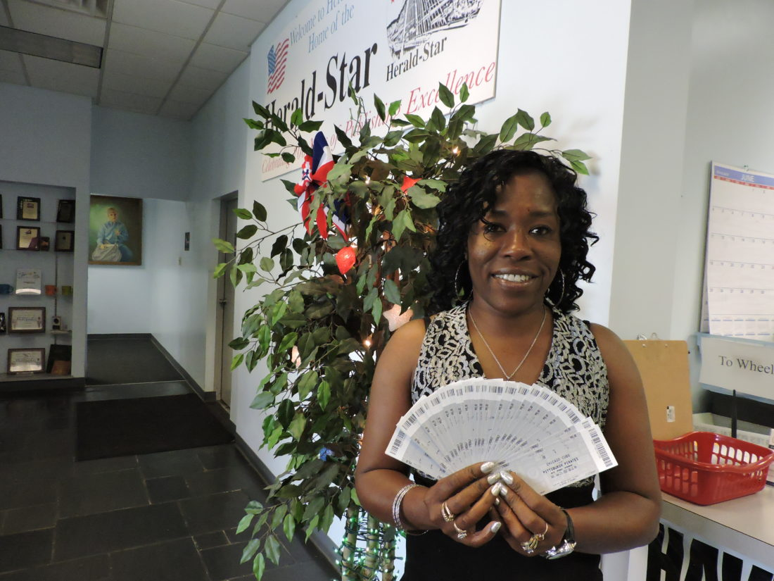 A SPECIAL EVENING PLANNED —  Diana Brown, a customer service representative for the Herald-Star and The Weirton Daily Times, shows off some of the tickets available for the newspapers' Community Night event on Aug. 4, when the Pittsburgh Pirates will play the San Diego Padres at PNC Park. The game will be followed by a concert by musical group Chicago. -- Jody Wisbith