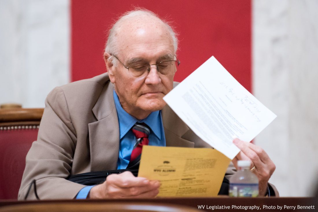 DOCUMENT REVIEWED — West Virginia Sen. Charles Clements, R-Wetzel, reviews documents during a floor session at the Capitol in Charleston in June. -- Perry Bennett, W.Va. Legislature