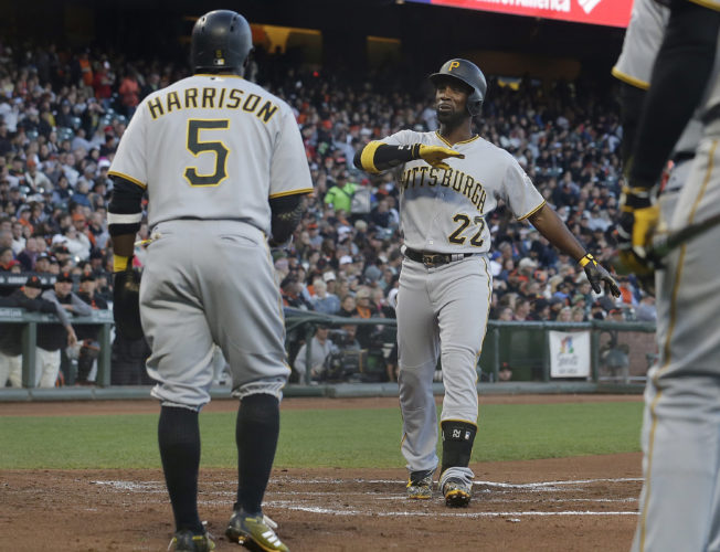 GIANT STATEMENT — Pittsburgh's Andrew McCutchen celebrates with Josh Harrison after hitting a three-run home run off of San Francisco pitcher Matt Cain during the second inning Monday in San Francisco. -- Associated Press