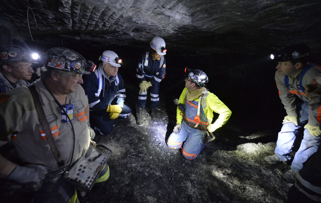 MINE SAFETY — Joe Main, third from left, Assistant Secretary of Labor for Mine Safety and Health, and Patricia Silvey, center, Deputy Assistant Secretary for Operations with MSHA, speak with workers at the Gibson North mine, in Princeton, Ind.