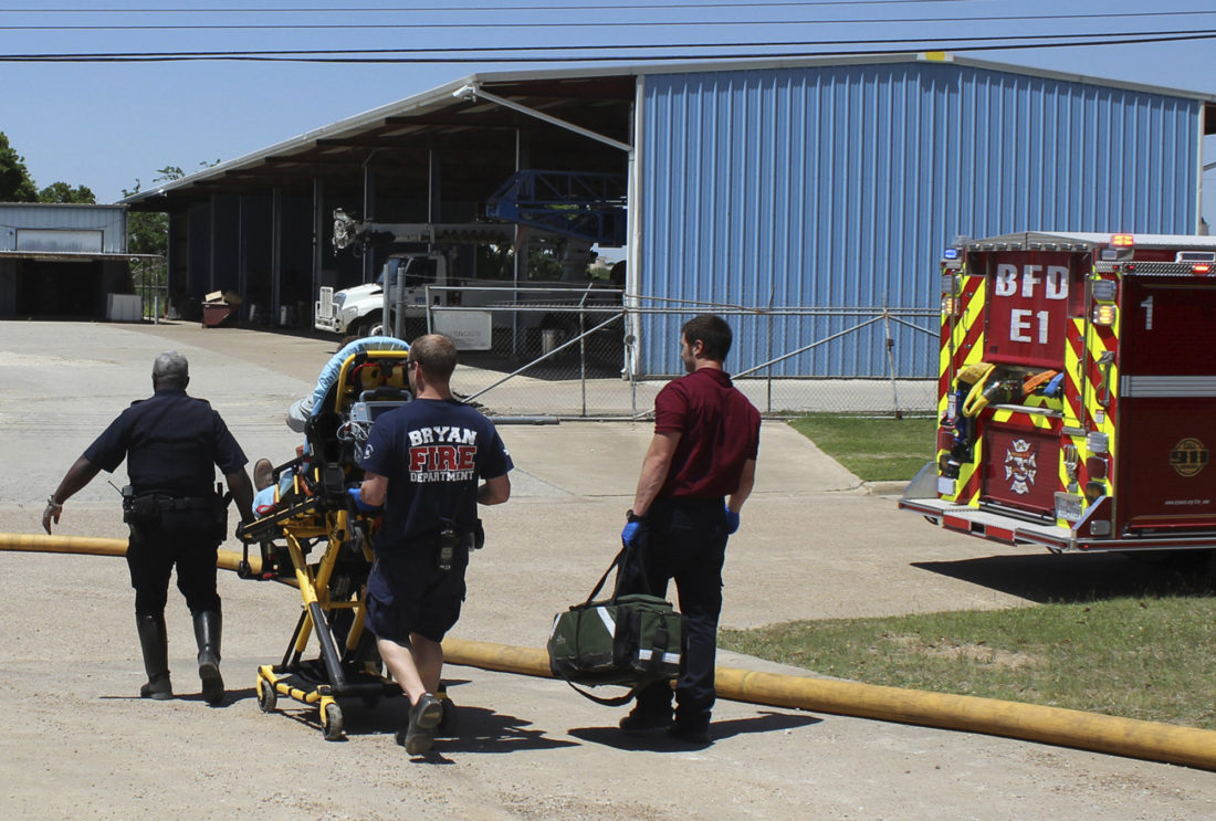 INJURED — Firefighters transport an injured worker in a stretcher to the ambulance. An explosion at the Bryan Texas Utilities Power Plant left Earle Robinson, 60, dead and two others injured.