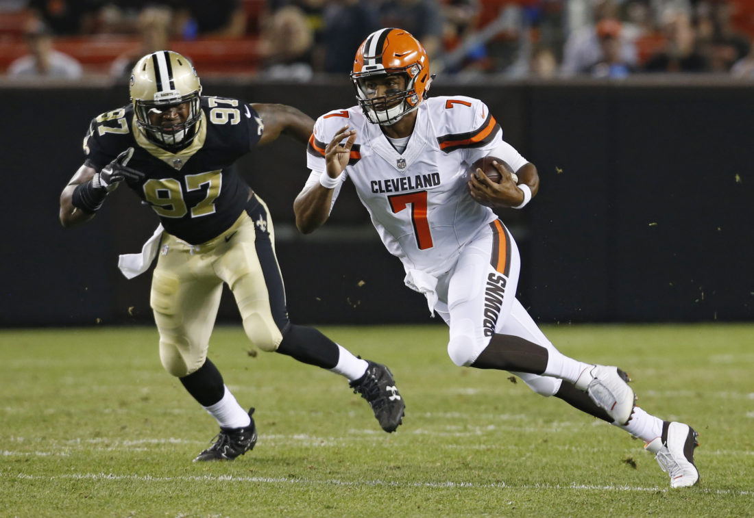 Cleveland Browns quarterback DeShone Kizer (7) runs against New Orleans Saints defensive end Al-Quadin Muhammad (97) during the second half of an NFL preseason football game, Thursday, Aug. 10, 2017, in Cleveland. (AP Photo/Ron Schwane)