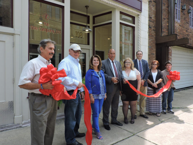 CEREMONY — A ribbon-cutting ceremony was held Wednesday at the newly established Title Co. Ltd. office located on South Fourth Street in Steubenville. On hand were, from left, Sam Halkias, president of the Ohio Land Title Association; state Sen. Frank Hoagland, R-Mingo Junction; Tammy Besece, business owner; Steubenville City Manager Jim Mavromatis; Lisa Paolucci, branch manager; T.J. Schultz, attorney who works with the title company; Lynne Majzun, an assistant to Schultz; and Nicolas Sacker, Paolucci's son. -- Jody Wisbith