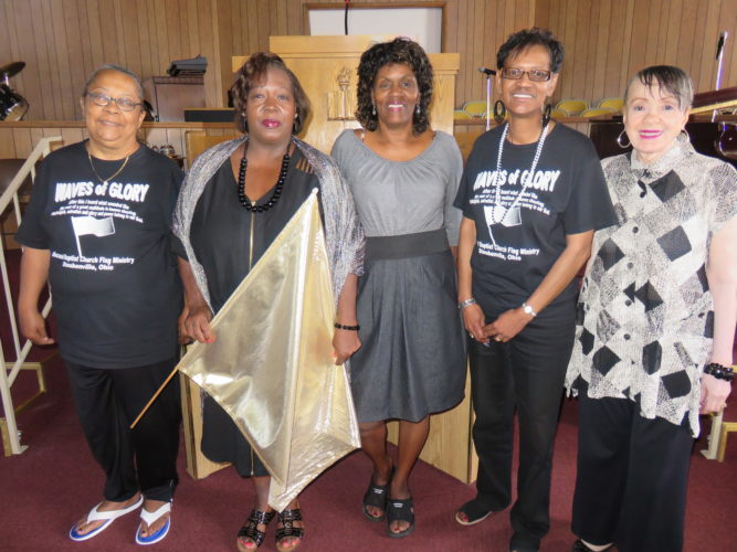 WAVES OF GLORY — Waves of Glory flag ministry members of Second Baptist Church, 717 Adams St., Steubenville, include,  from left, Melody Walton, Diane Benjamin, Terri Dixon, Pamela Ingram and Patricia Herring. The flag ministry will observe its anniversary with a program at 6 p.m. Friday that's open to the public and kicks offs the Women of Second Baptist's Women's Day weekend celebration. -- Janice Kiaski