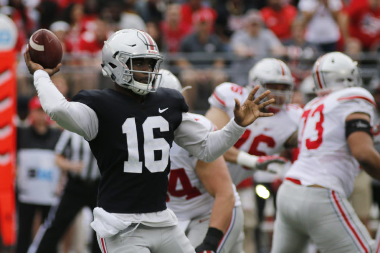 FILE - In this Saturday, April 15, 2017 file photo, Ohio State quarterback J.T. Barrett plays in their NCAA college spring football game in Columbus, Ohio. Barrett arguably is the best quarterback to ever play at Ohio State, but his issues with accuracy and decision-making along with inconsistent play from receivers and the offensive line contributed to the team's failings in big games last year, Wednesday, Aug. 16, 2017.  (AP Photo/Jay LaPrete, File)