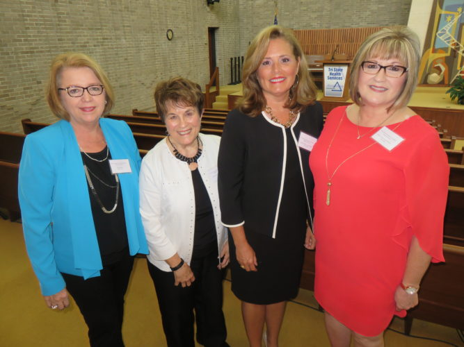 AT THE HEAD TABLE — Blanche Williams, second from left, president of the Ohio Valley Hospital/Trinity School of Nursing Alumni Association, has a photo opp with three presenters at the association's reunion held Saturday at the Prime Time Senor Center in Steubenville, including Judy Owings, left, Prime time director; Jefferson County Common Please Court Judge Michelle Miller, a an OVH School of Nursing graduate, Class of 1984; and Melissa Hassan, director of the school of nursing. -- Janice Kiaski