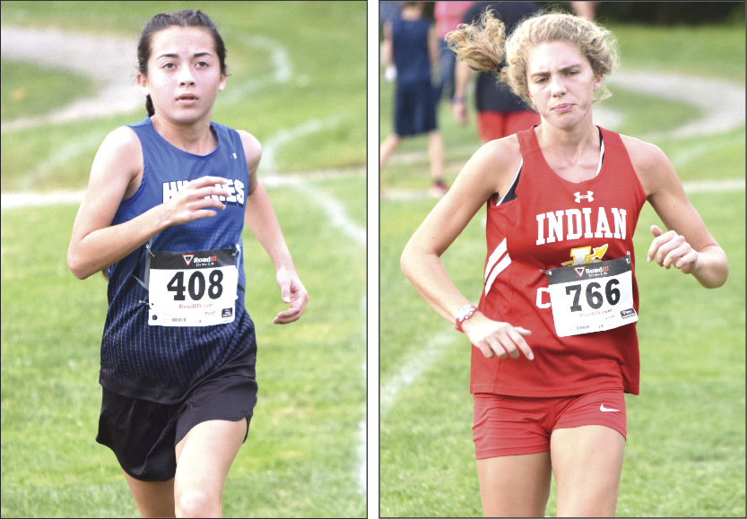 RUNNING HARD — Harrison Central's Jasmine Arnold (left) and Indian Creek's Leia Hunt compete in the Buckeye 8 Cross Country Championship on Wednesday at Buckeye Local. (Photo by Seth Staskey)