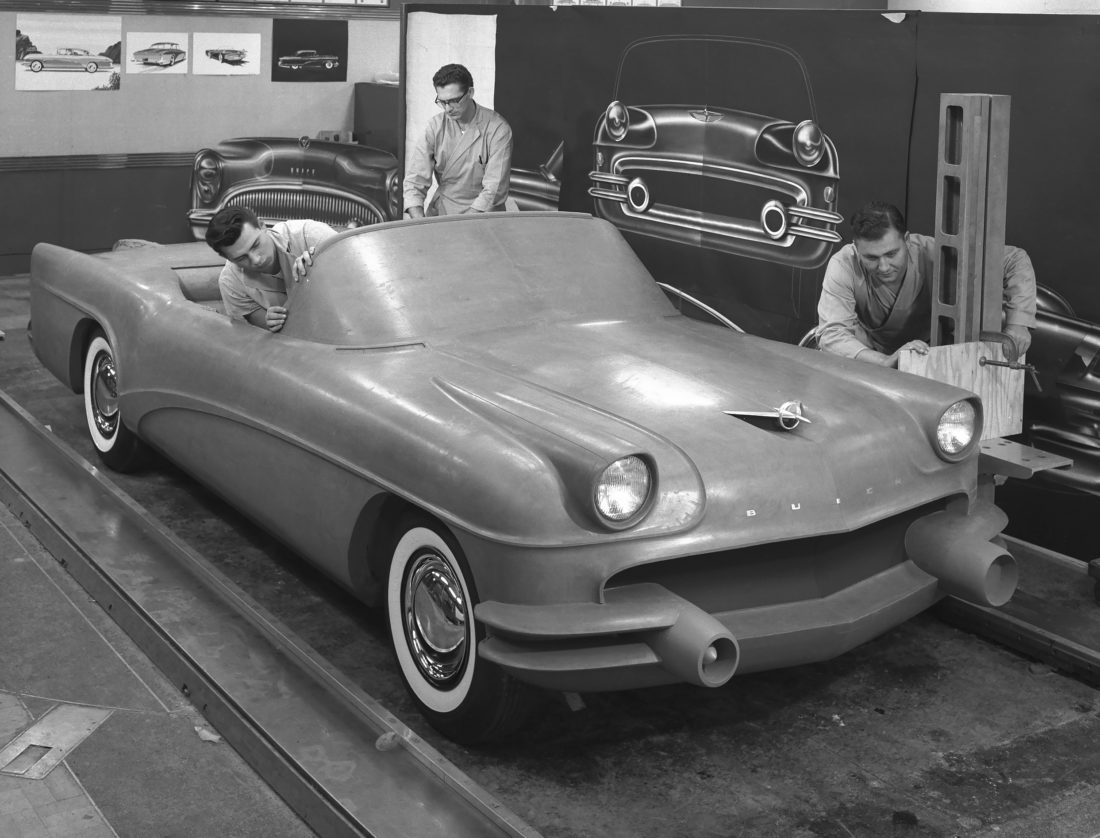 BUICK IN CLAY — This 1954 photo courtesy of General Motors shows Buick Design Studio creative clay sculptors as they mold the clay on a model GM automobile.