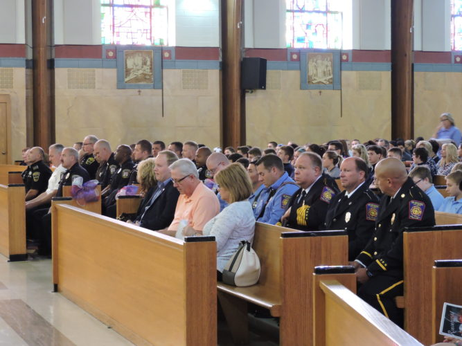 HONORED — Members of the Weirton Police Department, Weirton Fire Department and the Weirton Area Ambulance and Rescue Squad were honored Monday as part of a Blue Mass held at St. Joseph the Worker Church. -- Craig Howell