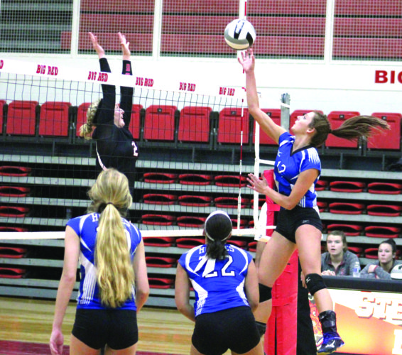 HIGH JUMP — Harrison Central's Lyndsey Hennis hits the ball against Steubenville on Tuesday. (Photo by Joe Catullo)
