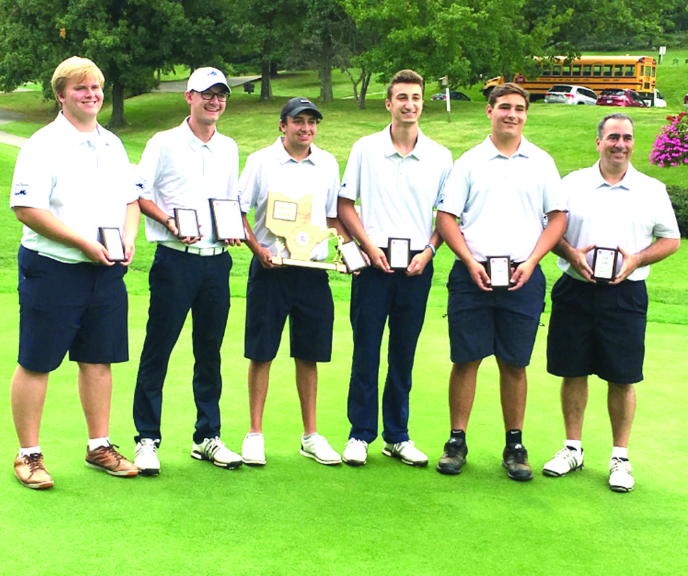 NINE IN A ROW — The Madonna golf team celebrates its OVAC championship on Tuesday. (Contributed)