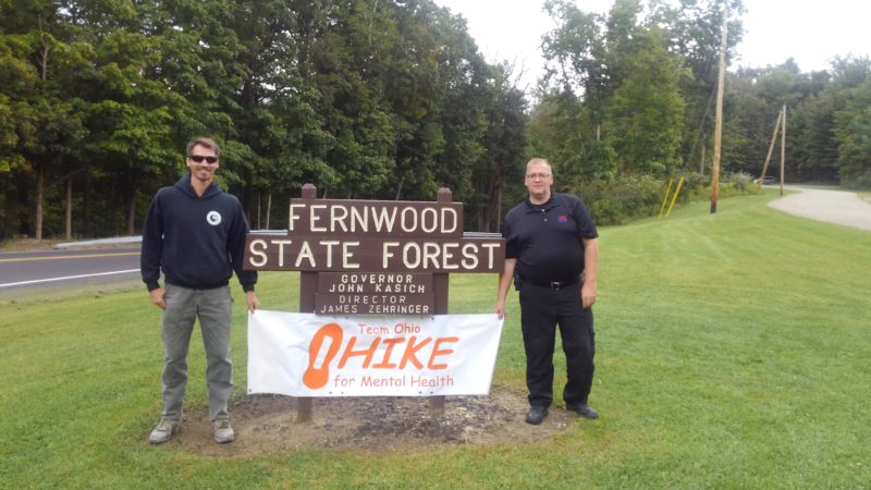 COMEANDWALK — Hiking enthusiast Michael T. Wood, right, invites area residents to join him on a fundraiser 3-mile hike through Fernwood State Forest on Sept. 30 beginning at noon. The HIKE for Mental Health is to help eliminate the stigma that surrounds mental illness, according to the Wintersville man, who is shown with Justin Law, forest manager, Fernwood State Forest. -- Contributed