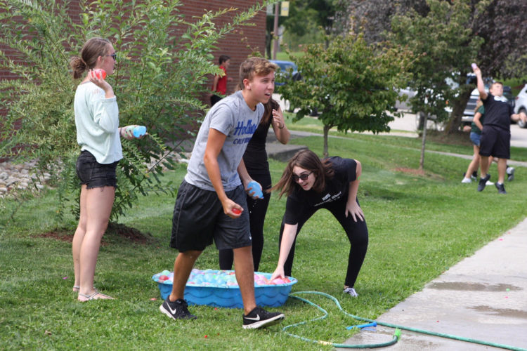 MAKING A SPLASH — Tyler Brozstek and others in the Brooke High School Spanish Club lobbed water balloons at each other while recreating the Spanish tradition of La Tomatina and raising money for the Brooke County Salvation Army. -- Contributed