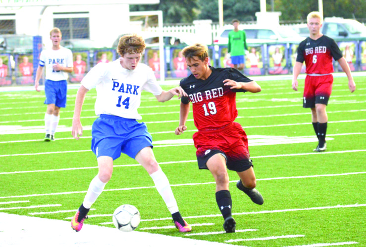 DEFENDING — Steubenville's Ian Phillips defends Wheeling Park's Phil White on Tuesday. (Photo by Kyle Lutz)