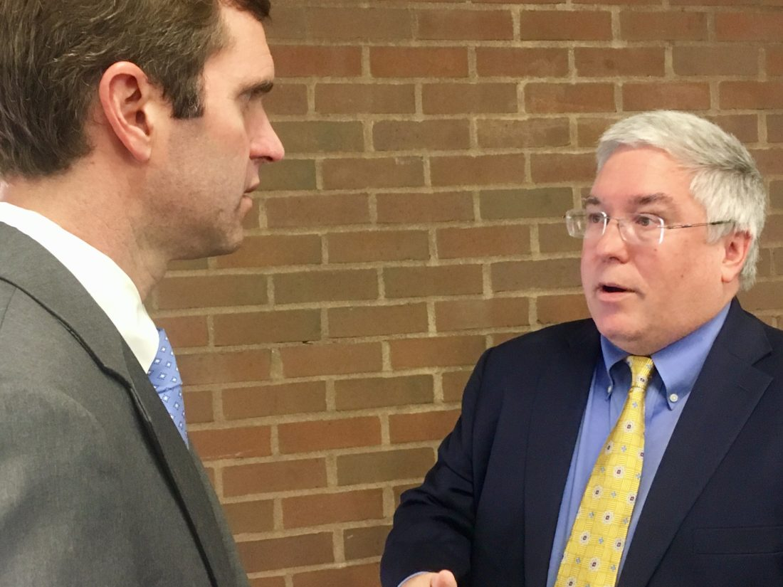 ATTORNEYS GENERAL IN TALKS — West Virginia Attorney General Patrick Morrisey, right, talks with Kentucky counterpart Andy Beshear following a news conference on opioid addiction Monday, at Marshall University in Huntington. -- Associated Press