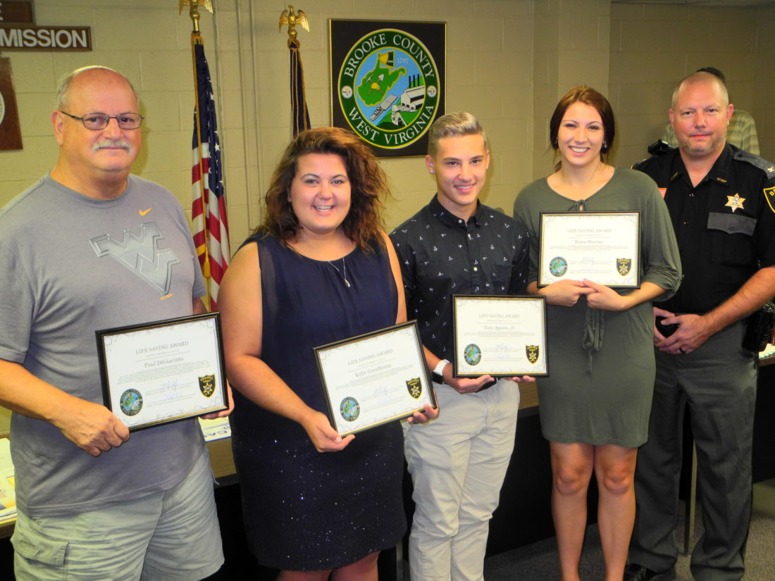 LIFE SAVERS — The Brooke County Commission and Sheriff Larry Palmer recognized eight residents for efforts that helped to save lives.  With Palmer, far right, are Paul DiGiacinto of Follansbee and Kylie Greathouse, Tony Apeosos Jr. and Kiara Stevens, all lifeguards at Brooke Hills Park. Also recognized were Mark and Theresa Kowcheck, Marla Ferguson and Wendy Sole.  -- Warren Scott