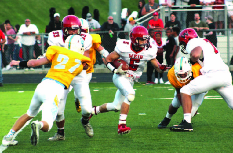 RUNNING BY — Weir's Chad Custer runs for yards against Oak Glen on Aug. 25 (photo by Joe Catullo).