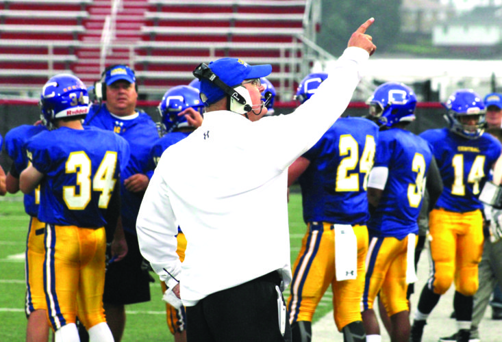 POINT TAKEN — Steubenville Catholic Central head coach Steve Daley points to his coaches before a game against Oak Glen on Sept. 2 (photo by Joe Catullo).