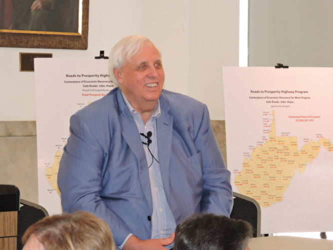 WEIRTONVISIT — Gov. Jim Justice sat before a crowd of more than 70 in the Weirton Room of the Millsop Community Center Wednesday evening, promoting the Roads to Prosperity road bond proposal which will go before the voters on Oct. 7. Early voting is set to begin Friday. -- Craig Howell