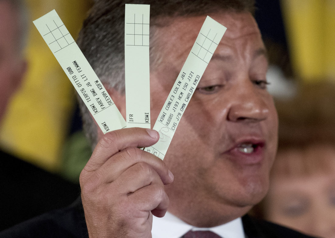 DEALINDOUBT — In this June  photo, Rep. Bill Shuster, R-Pa. holds up pieces of paper used by U.S. Air Traffic Controllers as he speaks about updating their systems during an Air Traffic Control Reform Initiative event in the East Room at the White House in Washington.  -- Associated Press