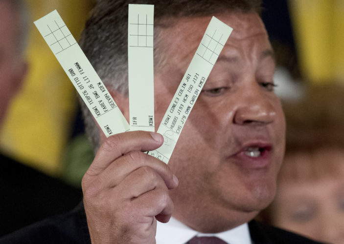 DEAL IN DOUBT — In this June  photo, Rep. Bill Shuster, R-Pa. holds up pieces of paper used by U.S. Air Traffic Controllers as he speaks about updating their systems during an Air Traffic Control Reform Initiative event in the East Room at the White House in Washington.  -- Associated Press
