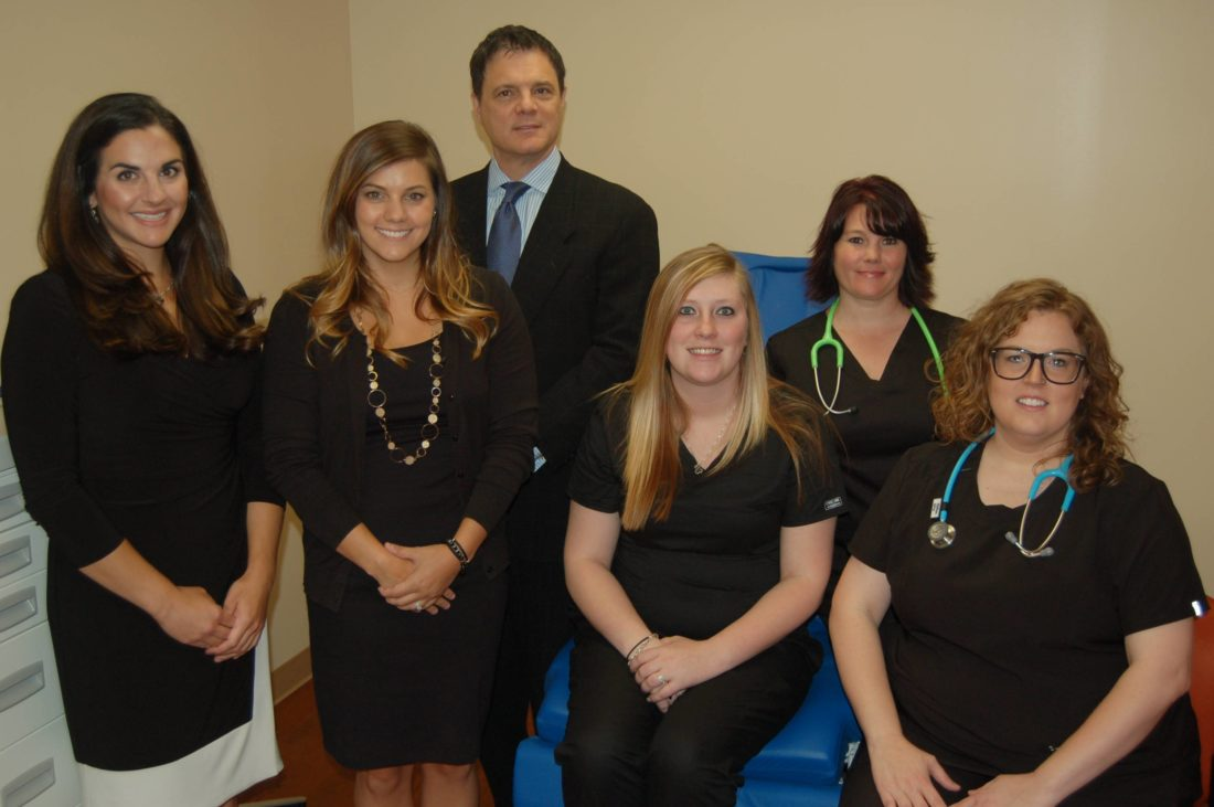 GAINS ACCREDITATION — The bariatric surgery center at Trinity Health System has achieved national accreditation, Dr. Joseph Colella, shown here with his staff, has announced. -- Contributed
