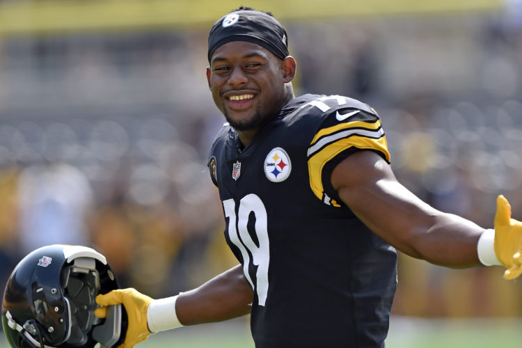 FILE - In this Sunday, Sept. 17, 2017, file photo, Pittsburgh Steelers wide receiver JuJu Smith-Schuster warms up before an NFL football game in Pittsburgh. The youngest player in the NFL wears SpongeBob slippers and scored the first touchdown of his career last weekend, though 20-year-old Steelers wide receiver JuJu Smith-Schuster may have turned more heads with a crunching block that showed the NFL is child's play. (AP Photo/Don Wright, File)