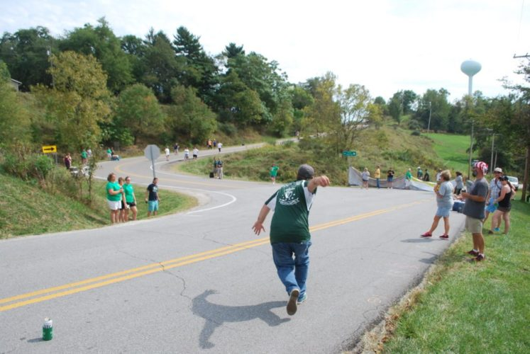 ON THE ROAD — A competitor prepares to throw an iron ball on Park View Road in Wheeling during a past Irish Road Bowling Ohio Valley Championship. This year's event is Saturday. -- File photo