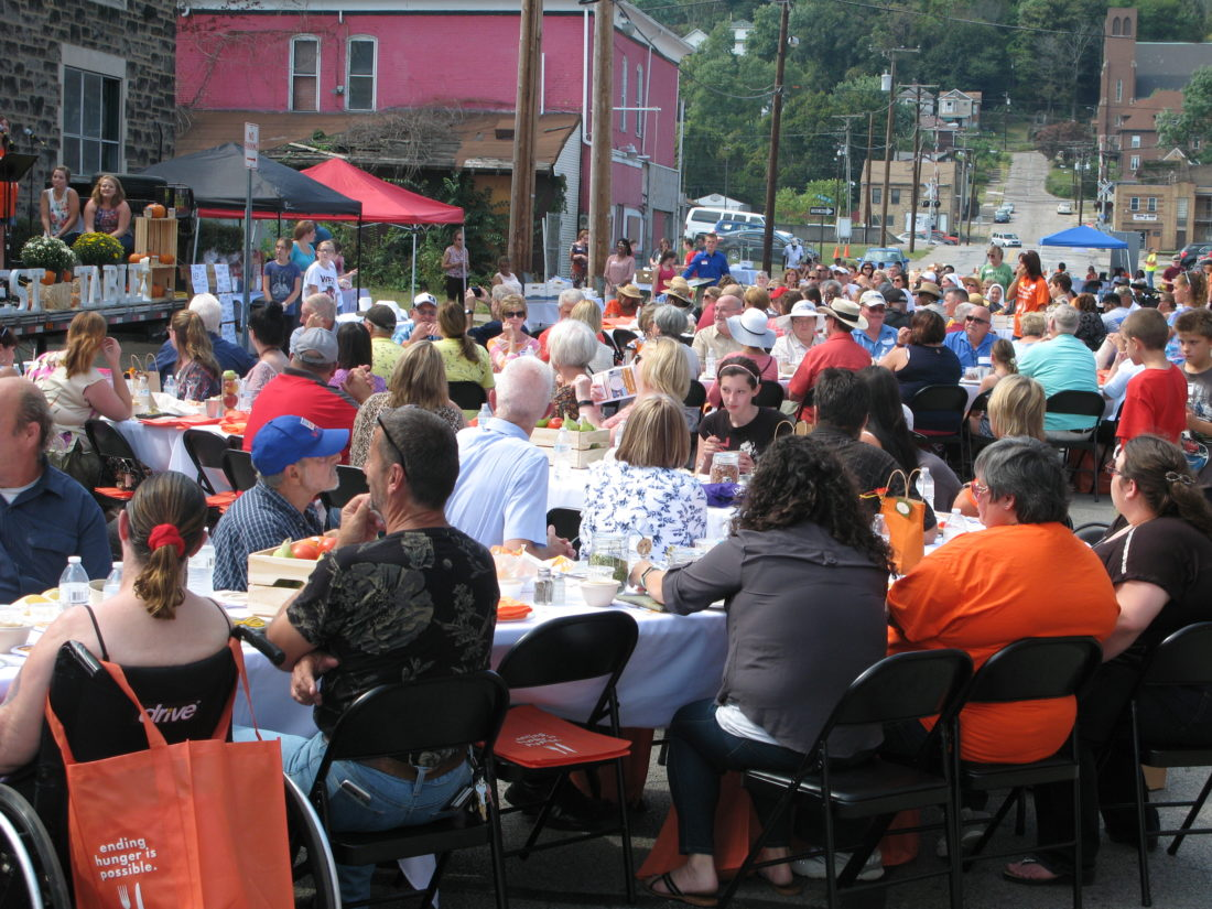 LONGEST TABLE — About 300 people attended Sunday's Longest Table event on North Street in Steubenville. The event was sponsored by the Urban Mission Ministries to bring awareness to hunger in the community. Volunteers served a family-style dinner. -- Mark Law