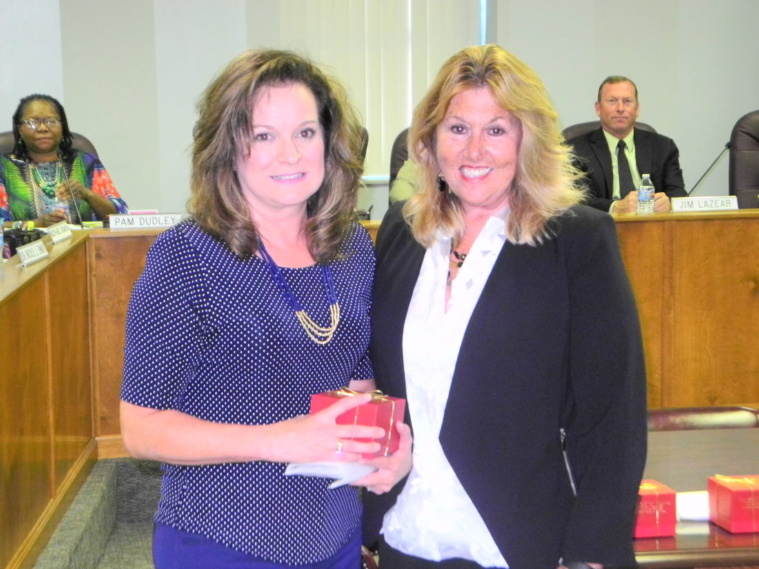 TEACHER OF THE YEAR — The Brooke County Board of Education on Monday recognized Tammy Cutshall, left, as the Brooke County Teacher of the Year. With her is Superintendent Toni Paesano Shute. -- Warren Scott