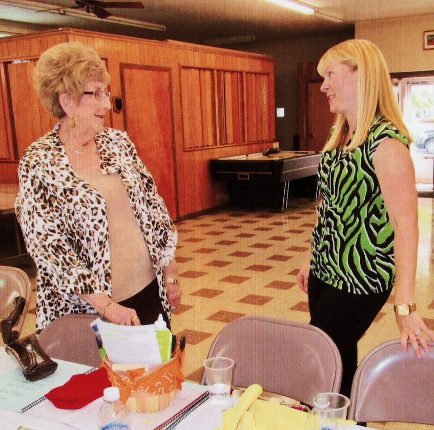 SPECIAL EVENT — Rita Kilmartin, left, and Brandy Puskarich-Bradley exchange greetings before the start of the 90th anniversary celebration of the GFWC WV Follansbee 20th Century Club. -- Contributed