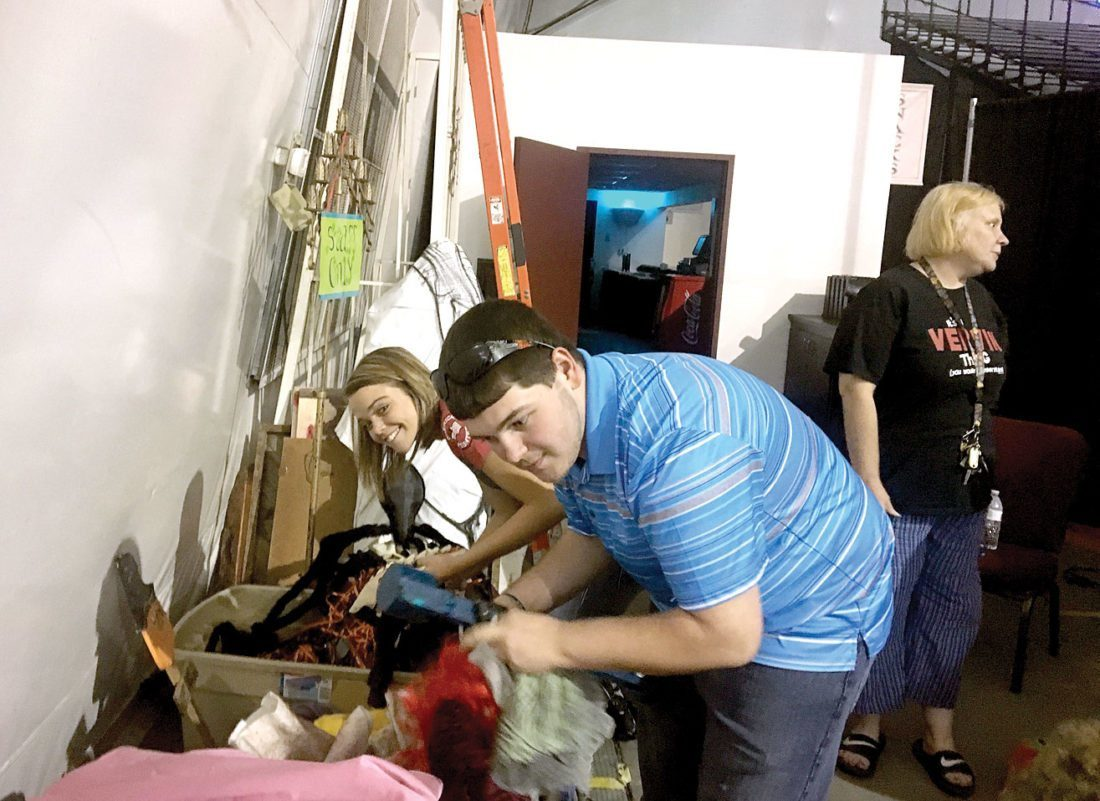 "HAUNTED HARV — Junior Beacons Alyssa Adkins and Christopher Pritt have been earning community service hours by organizing masks and costumes in preparation for the ""Haunted Harv,"" which opened Thursday at The Harv at Mountaineer Casino, Racetrack & Resort in Chester. -- Paula Vaughn"