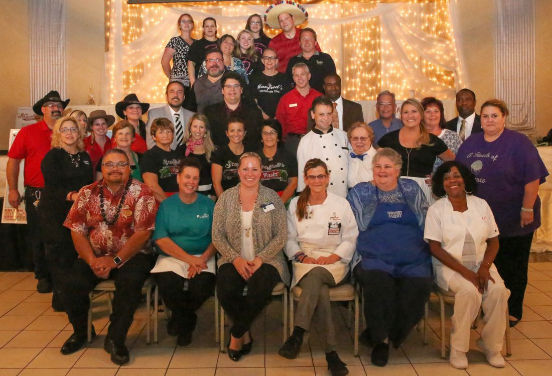 """Contributed  THEYMAKEITHAPPEN —  """"Around the World"""" was the theme of the 23nd-annual Taste of the County held Oct. 4 at St. Florian Hall in Wintersville, giving area residents an opportunity to sample the specialties of area restaurants, bakeries and caterers while supporting the fundraiser sponsored by the United Way of Jefferson County. Participants included A Touch of Elegance, Downtown Bakery, Mama G's, Piergallini Catering, The Ville, Mandred's Catering, Ohio Valley Sno, Little Snack Shack, Scaffidi's Restaurant, Texas RoadHouse, The Laurel's of Steubenville, Sugar Rushed Bakery, the YWCA of Steubenville, The Inn at Franciscan Square, Momma Maria's, Margaret's CafÈ, Tim Horton and the Jefferson County Joint Vocational School Crestview Inn. Mystery bags were sponsored by McCauslen's Florist in Steubenville, and Dart Destination was sponsored by Discovery Jewelers of Wintersville. The winners of Dart Destination were Amy McDonnell, a necklace; Todd Piergallini, a hot air balloon ride for two; and Flo Rakich, a picnic table and picnic items."""