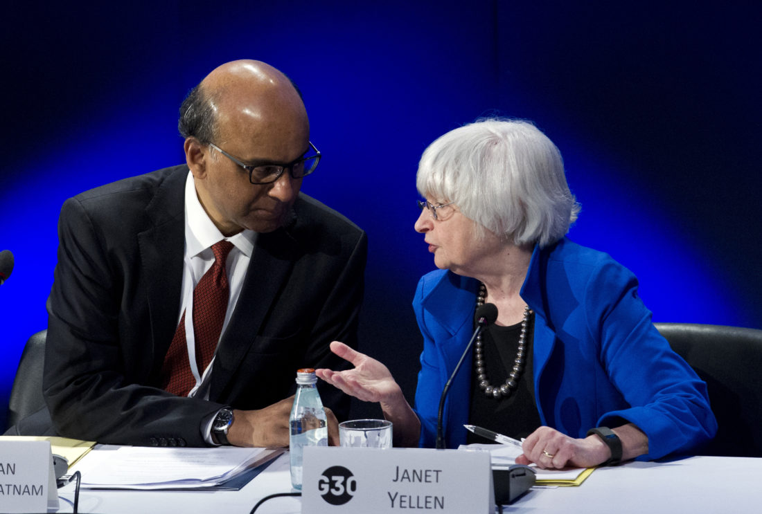 BANKING SEMINAR TALK — U.S. Federal Reserve Chair Janet Yellen speaks with G30 Chairman, Singapore Deputy Prime Minister Tharman Shanmugaratnam, during the G30 International Banking Seminar at Inter-American Development Bank headquarters in Washington Sunday. -- Associated Press