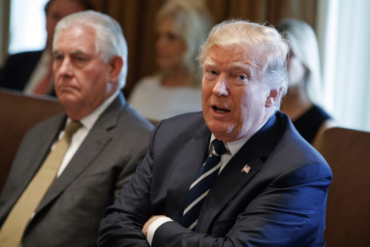 IN THE CABINET — President Donald Trump speaks during a cabinet meeting at the White House, Monday, in Washington, as Secretary of State Rex Tillerson listens. -- Associated Press