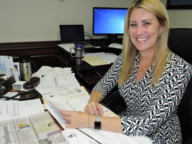 PREPARING FOR CONFERENCE — Erikka Storch, president of the Wheeling Area Chamber of Commerce, prepares for the 2017 Economic Outlook Conference, set for 7:30 a.m. Wednesday at Wheeling Island Hotel, Casino and Racetrack. -- Casey Junkins