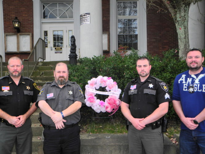 Warren Scott NO-SHAVE NOVEMBER — Members of the Brooke County Sheriff's Department may grow neatly kept beards while making donations to the American Cancer Society in observance of No-Shave November. Among those participating are, from left, Sheriff Larry Palmer; Aaron Jones, administrative assistant for the department; Sgt. Kyler Ferguson and Cpl. Gary Conley, who currently serves as a plainclothes detective.