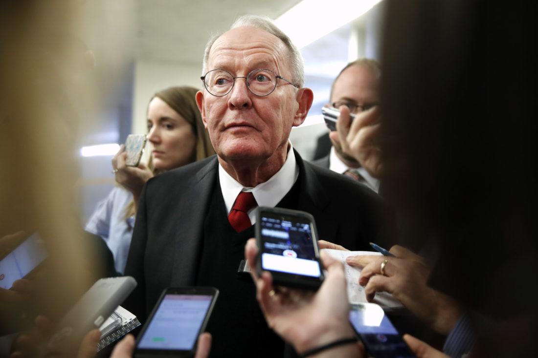 READYTOVOTE — Sen. Lamar Alexander, R-Tenn., speaks to reporters as he heads to vote on budget amendments, Thursday, in Washington. -- Associated Press