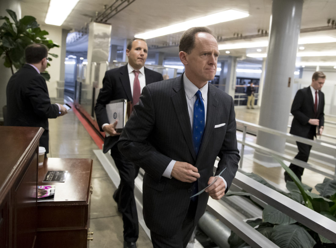 Sen. Pat Toomey, R-Pa., a member of the Senate Budget Committee, heads to the floor during a series of votes at the Capitol in Washington, Thursday. -- Associated Press
