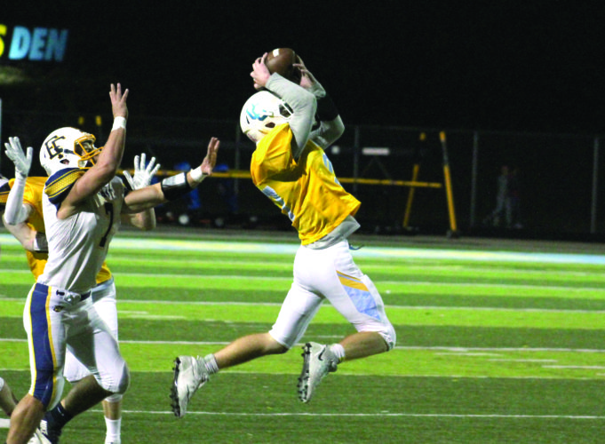 Oak Glen's Blake Almo intercepts a pass against East Fairmont on Friday. (Photo by Joe Catullo)