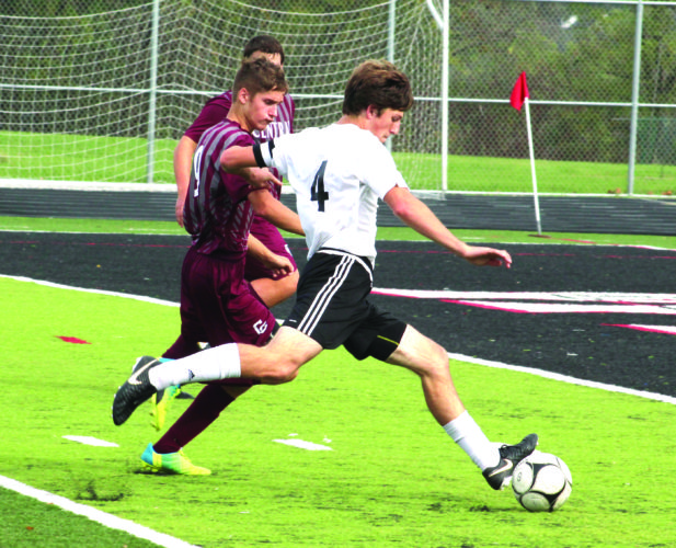 RACING AWAY — Weir's William Rice races to the net past Wheeling Central's Jack Stryker during a Class AA/A Region 1, Section 1 final on Saturday. (Photo by Joe Catullo)