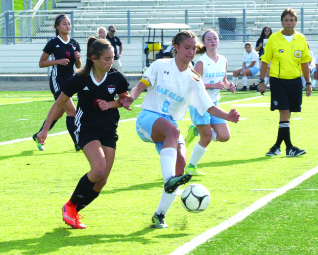 Oak Glen's Abigail Myers plays the ball in front of Weir's Bella Aperfine during a Class AA/A Region 1, Section 1 final on Saturday. (Photo by Andrew Grimm)