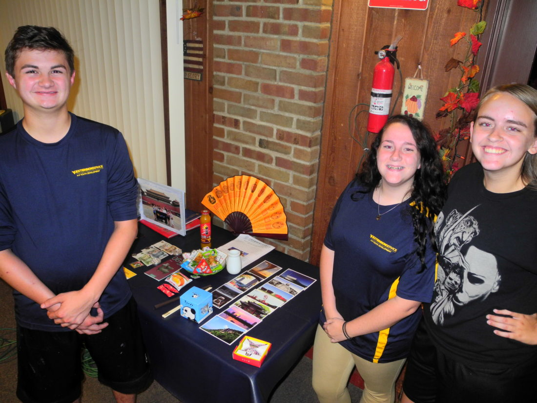 CHINA VISITORS — Brooke County 4-H members, from left, Dante Johnson, McKenzie Cross and Mikayla Wood recently discussed their trip to China this summer through the West Virginia University Extension Service and displayed the variety of souvenirs they brought home. -- Warren Scott