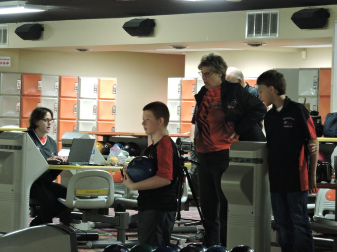 PRO POINTERS — Michelle Mullen, seated at left, and Aleta Rzepecki-Sill, standing, were on hand at Holiday Lanes in Weirton Saturday, offering a clinic for 13 area youth bowlers to assist them in improving their skills. A similar clinic was offered for adults in the afternoon. -- Craig Howell