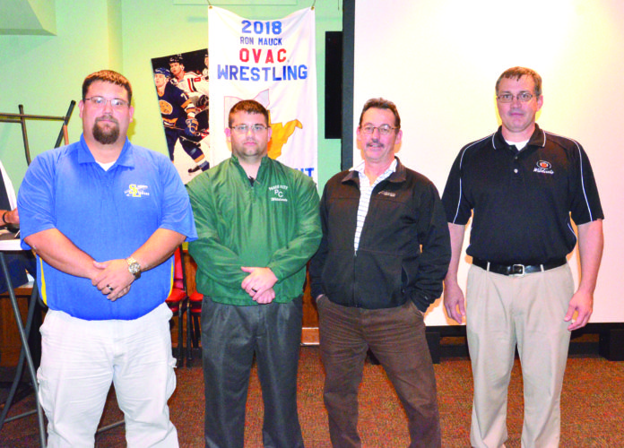 """NEW FACES — The Ohio Valley Athletic Conference wrestling community welcomed seven new head coaches to the """"family"""" during a press conference Monday night inside WesBanco Arena. They are, from left, Jimmy Malone (Southern Local), Michael Owens (Paden City), Scott Hiemstra (East Liverpool) and Jimmy Benson (Edison). Other new coaches are Jamie Lesho (Madonna), Derrick Hesson (Caldwell) and Vic Nery (Crestview). -- Kim North"""